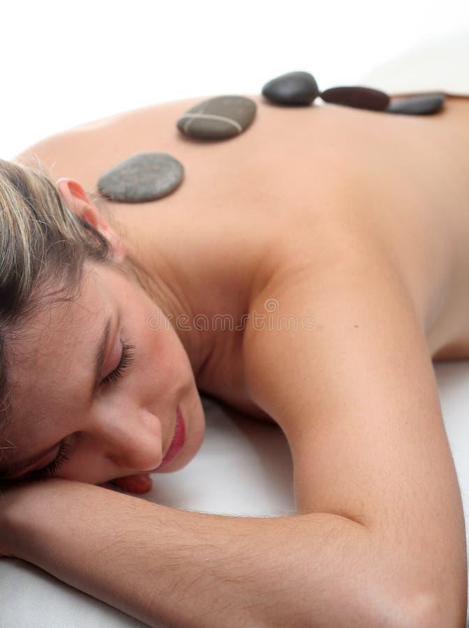 Hot stone massage royalty free stock photography