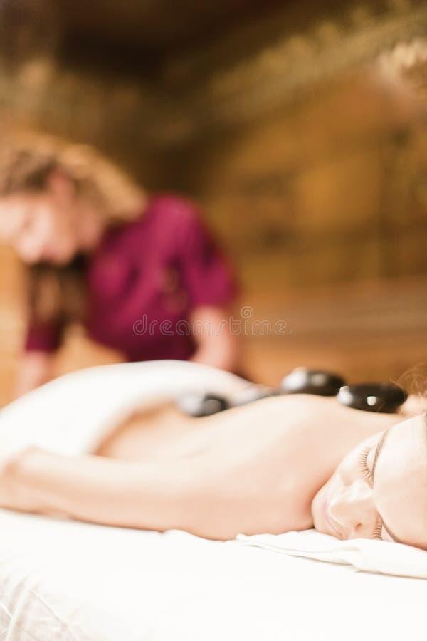 Hot stone massage therapy stock photo