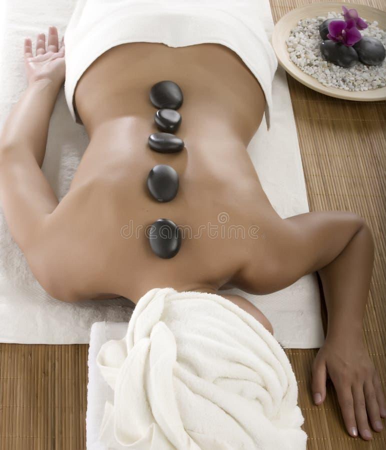 Hot stone treatment stock photos