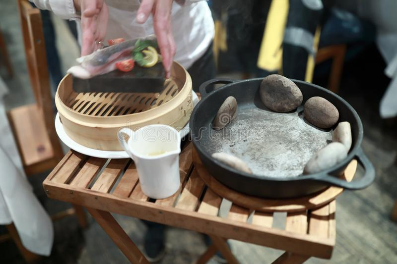 Hot stones in pan. For cooking fish royalty free stock photo