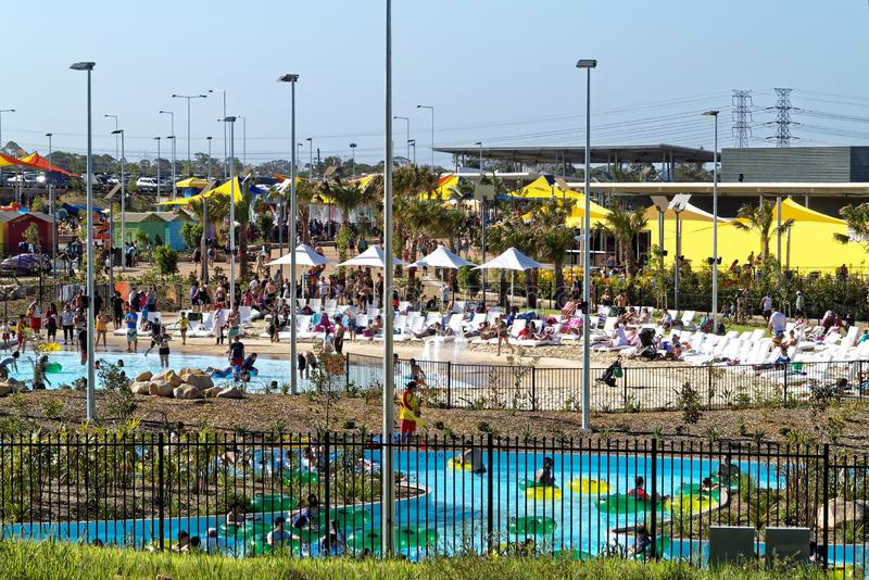 Water park on hot summer day people relax in and at pool royalty free stock image
