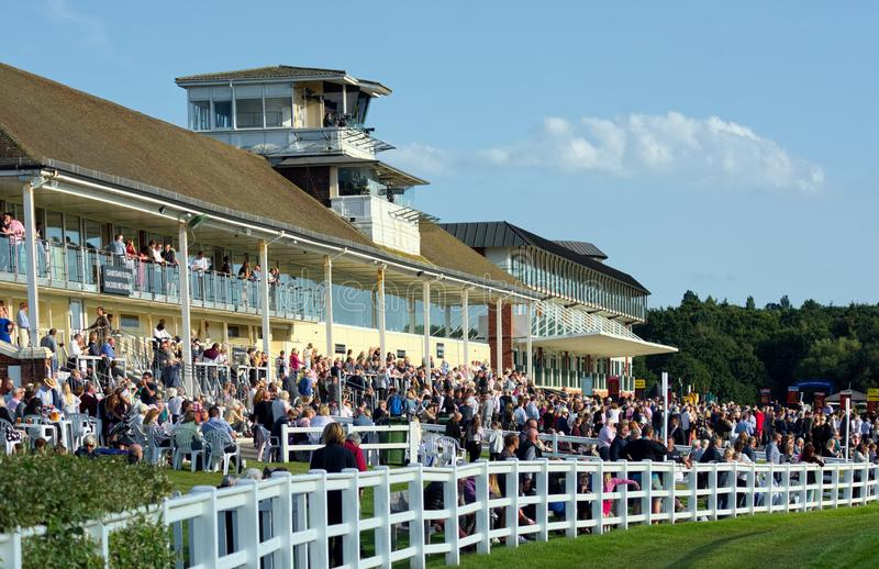 Lingfield Park Racecourse. Grandstand.  UK. Hot summer evening horse racing is always popular at the countryside track of Lingfield Park, in Surrey, UK. Usually royalty free stock image