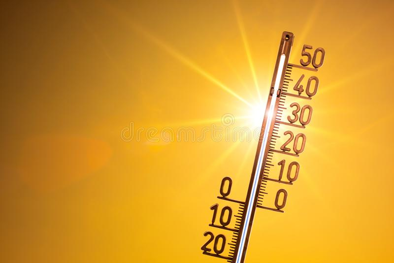 Heat wave, bright sun on orange sky royalty free stock image