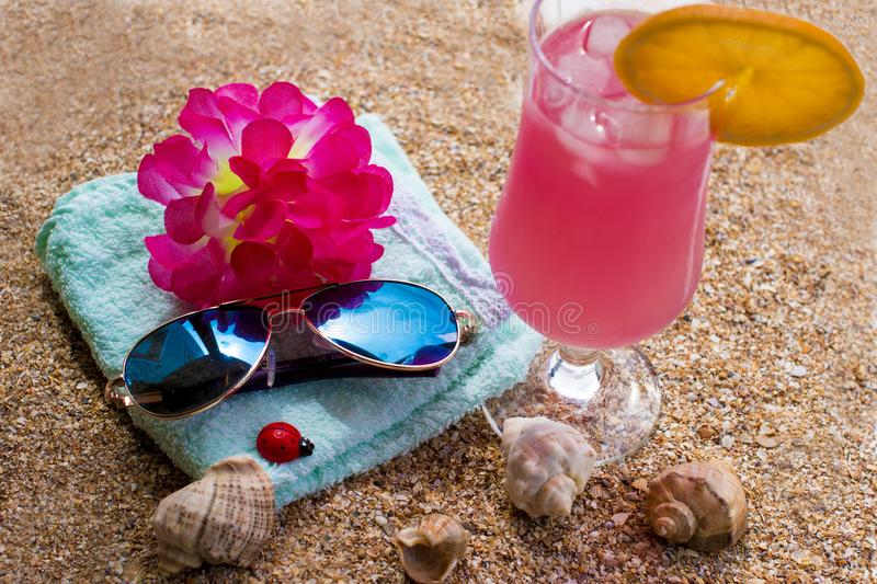 Hot summer and sandy beach. With a cold drink stock photography