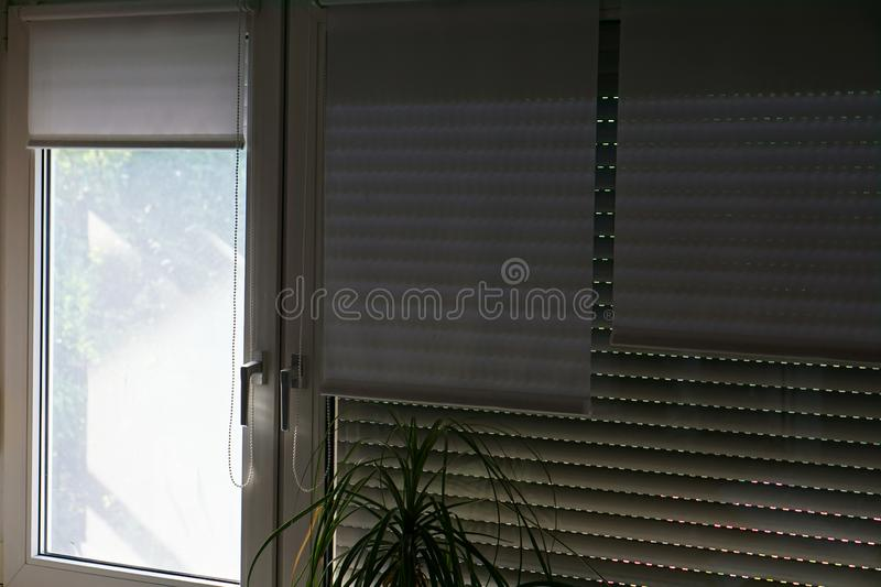 So that the hot sun does not shine in the room. Window shutters are down so that the hot sun does not shine in the room image design royalty free stock images