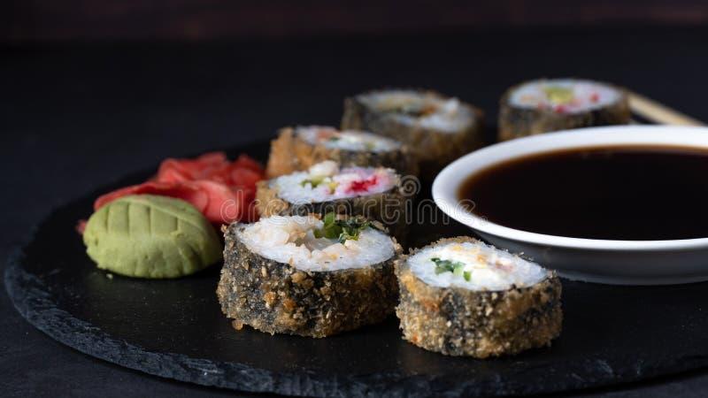 Hot Sushi Roll with salmon, eel, tuna, avocado, royal prawn, cream cheese Philadelphia, caviar tobica, chuka royalty free stock photography