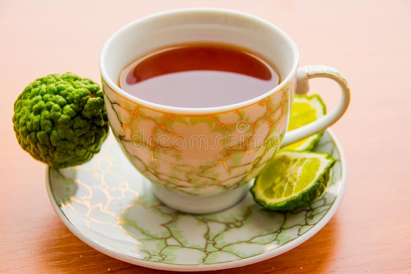 Hot tea with bergamot on wooden table in the cold. Winter stock photography