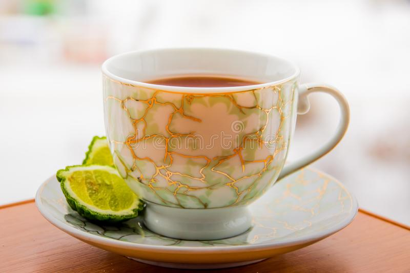 Hot tea with bergamot on wooden table in the cold. Winter stock photo