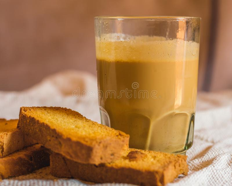 Hot tea and biscuits in the evening royalty free stock photography