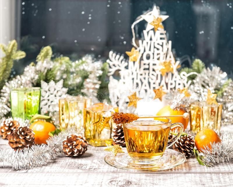 Hot tea Christmas window decoration Winter food drinks royalty free stock images