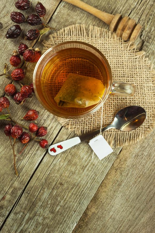 Hot tea for colds. Traditional home treatment for colds and flu. Rosehip tea, honey and citrus. Home Pharmacy. Proven treatment of diseases stock photo