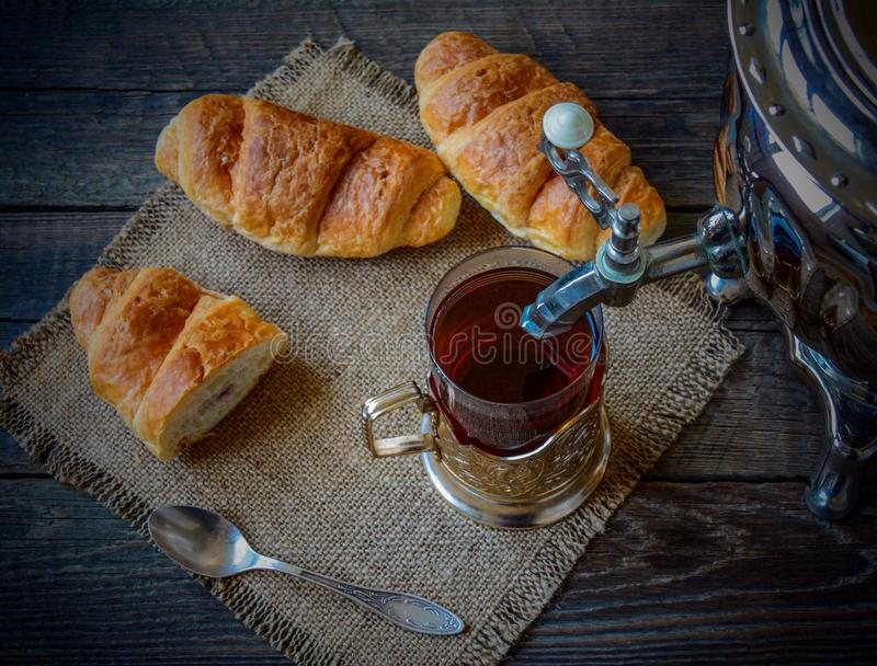 Croissant. Hot fresh tea with croissant stock images