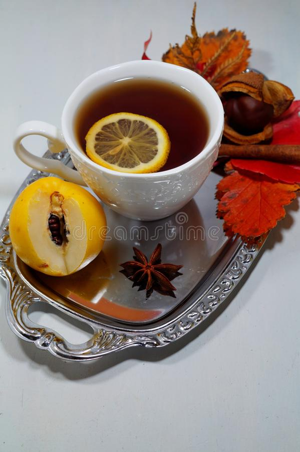 Hot tea with lemon in autumn and winter evenings - an alternative to antibiotics - selective focus. Hot tea with lemon in autumn and winter evenings - an royalty free stock photography