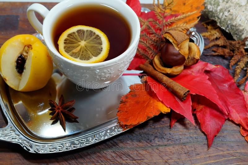 Hot tea with lemon in autumn and winter evenings - an alternative to antibiotics - selective focus. Hot tea with lemon in autumn and winter evenings - an stock photos