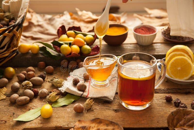 Hot tea with lemon and honey. stock photos