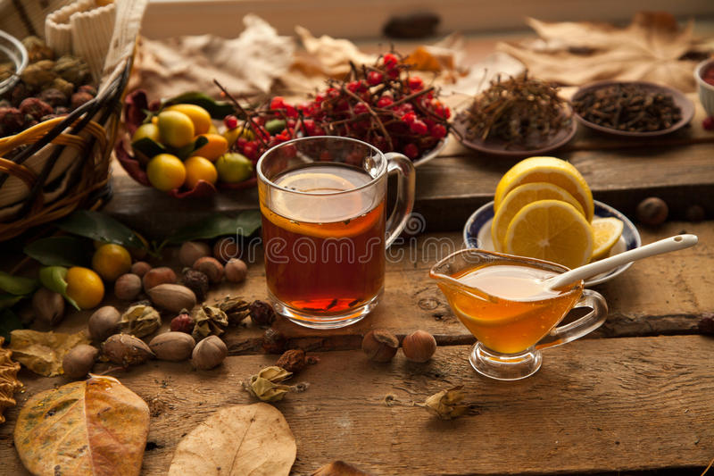 Hot tea with lemon and honey. royalty free stock photos