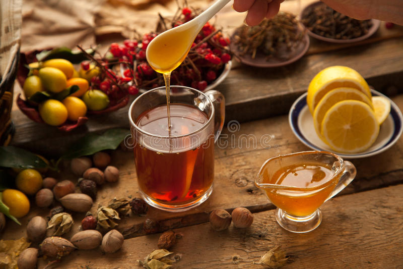 Hot tea with lemon and honey. stock photo