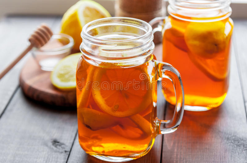 Hot tea with lemon and natural honey, good treat to have vitamins and strong immunity. royalty free stock photos