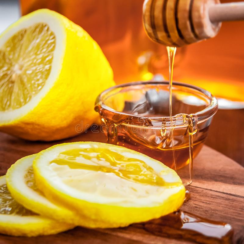Hot tea with lemon and natural honey, good treat to have vitamins and strong immunity. royalty free stock photo