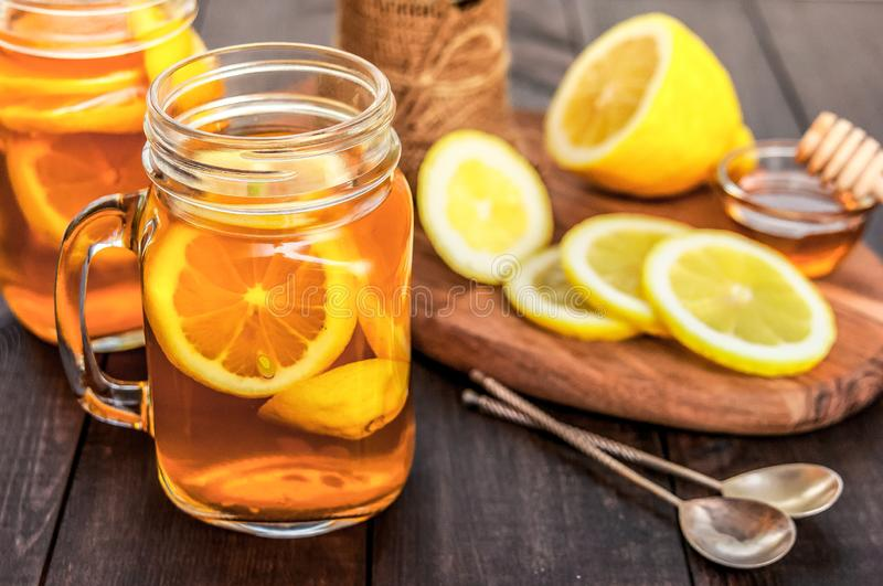 Hot tea with lemon and natural honey, good treat to have vitamins and strong immunity. royalty free stock image