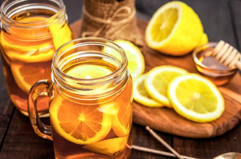 Hot tea with lemon and natural honey, good treat to have vitamins and strong immunity. royalty free stock photography