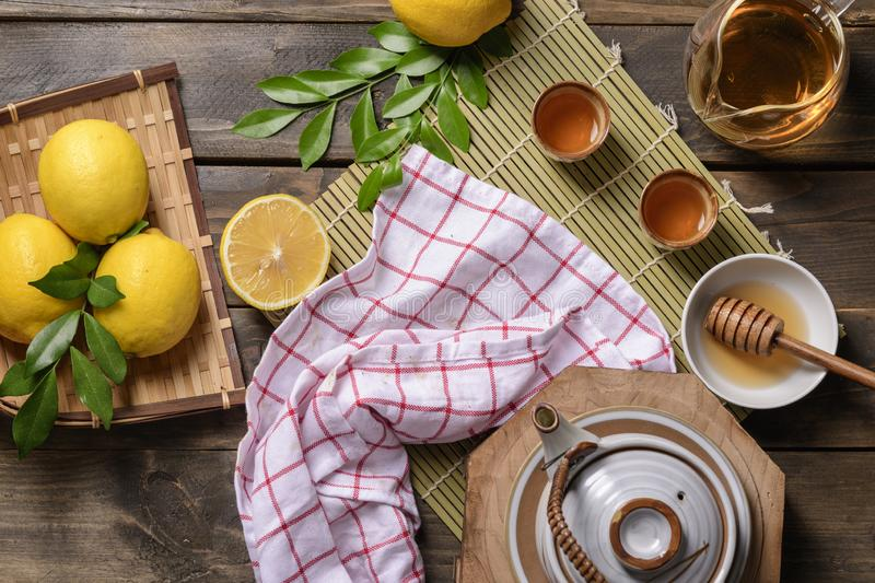 Hot tea with lemon and natural honey stock images