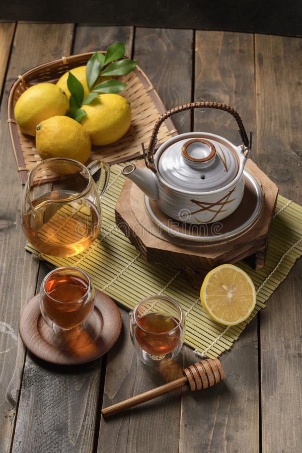 Hot tea with lemon and natural honey stock image