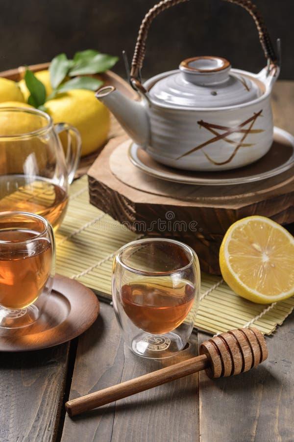 Hot tea with lemon and natural honey royalty free stock photos