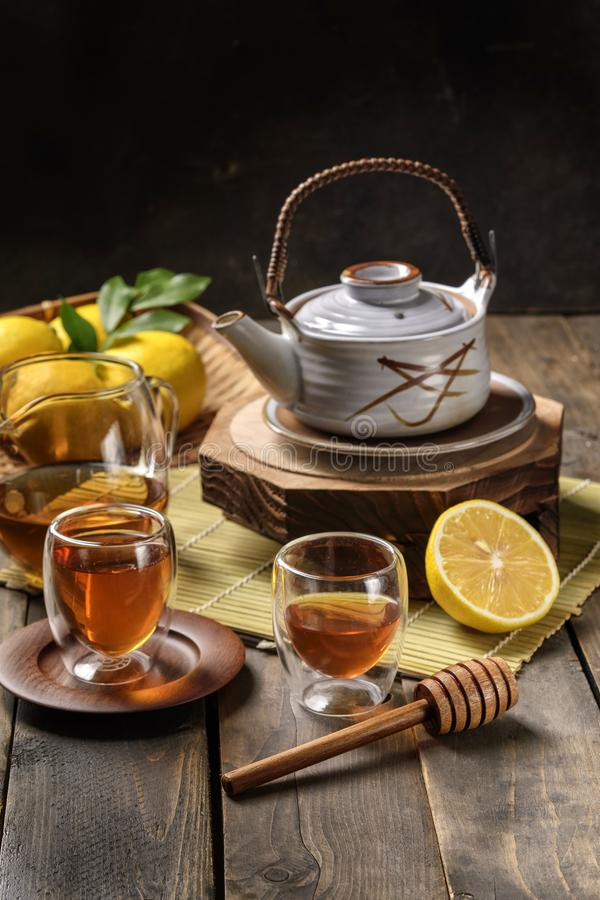 Hot tea with lemon and natural honey royalty free stock images