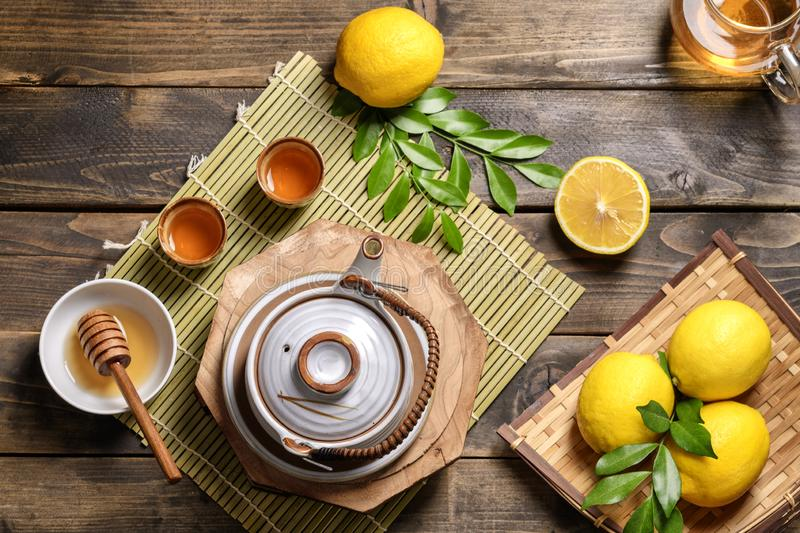 Hot tea with lemon and natural honey stock photography