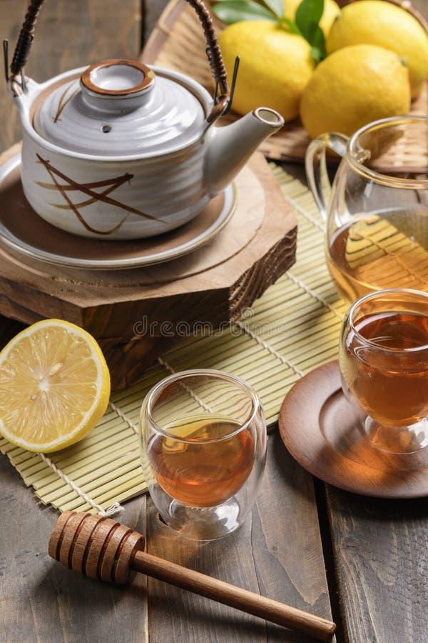 Hot tea with lemon and natural honey stock photo