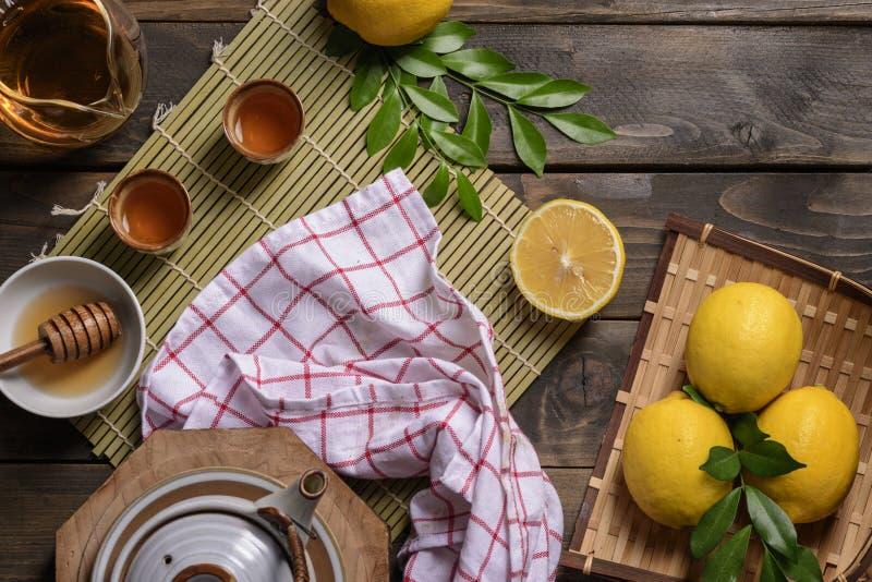 Hot tea with lemon and natural honey royalty free stock photo
