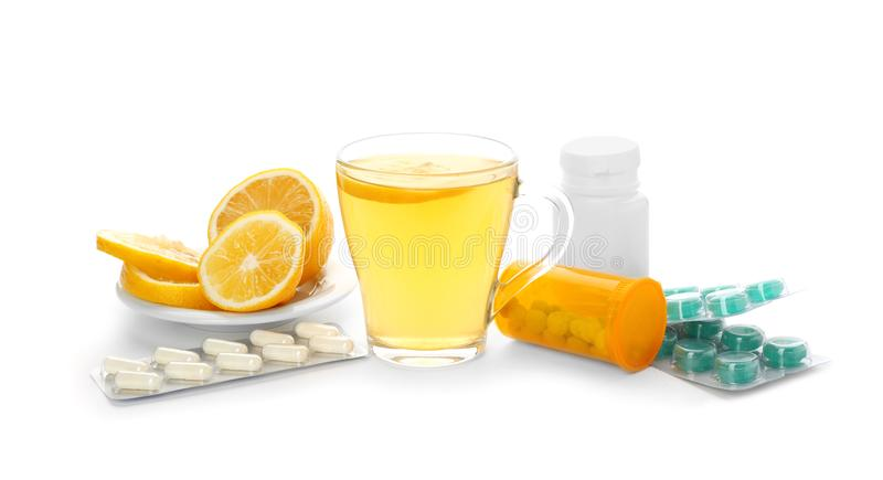 Hot tea with lemon, pills and drugs for cold royalty free stock image