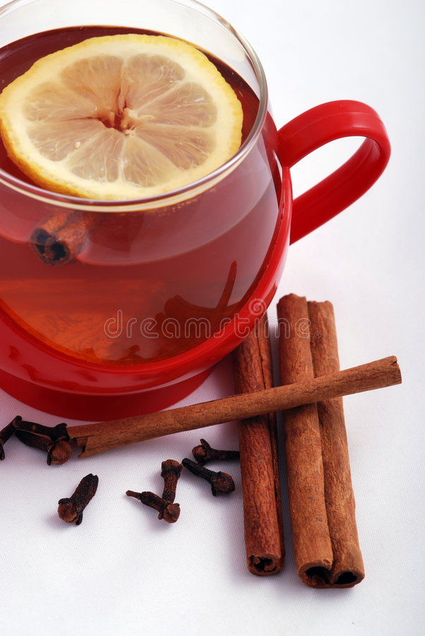 Hot tea with spices stock photography