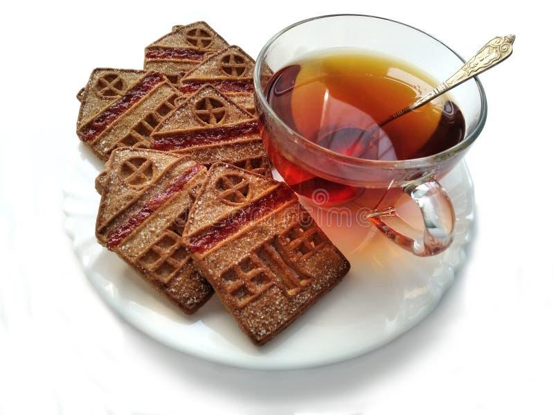 Hot tea and sweet cookies stock photos