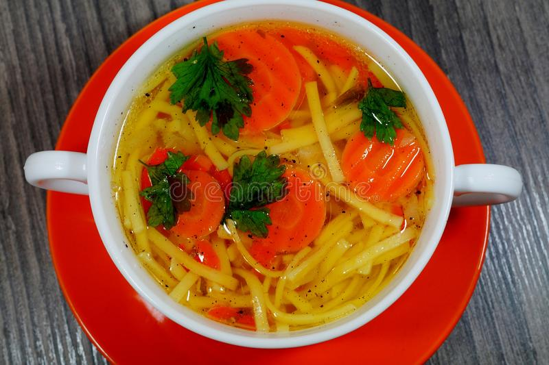 Hot traditional chicken soup in a white dish - energy and warming meal on a cold day stock photos