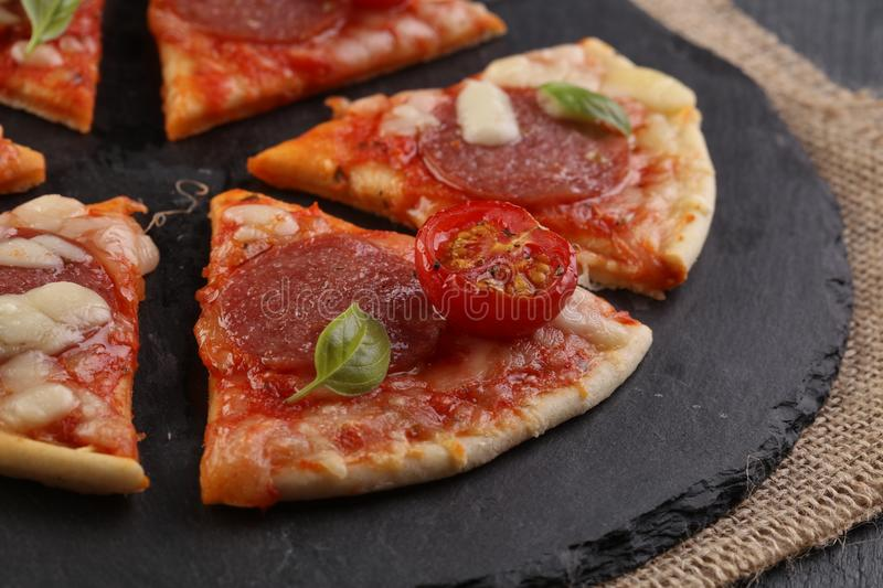 Hot true PEPPERONI ITALIAN PIZZA with salami and cheese. TOP VIEW Tasty traditional pepperoni pizza on board on wooden table with stock photo