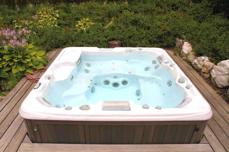 Hot Tub. A Jacuzzi or hot tub outside on a deck royalty free stock images