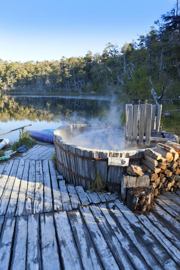 Hot Tub Spa Nature Lake. A hot tub in southern Chile wilderness. Lake of the Frogs can be seen in the background. Near Futaleufu, Chile. Located in Palena stock photos