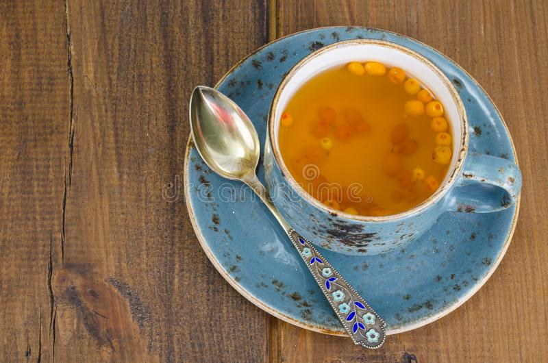 Hot vitamin drink with delicious orange sea buckthorn. Studio Photo stock images