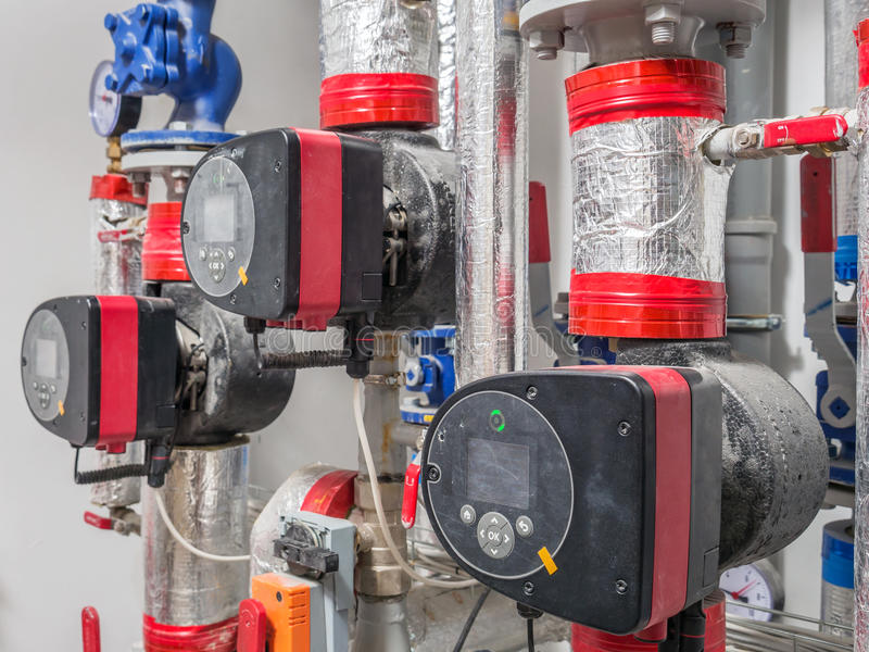 Hot water circulating pumps. Group of hot water circulating pumps installed in boiler room royalty free stock photos