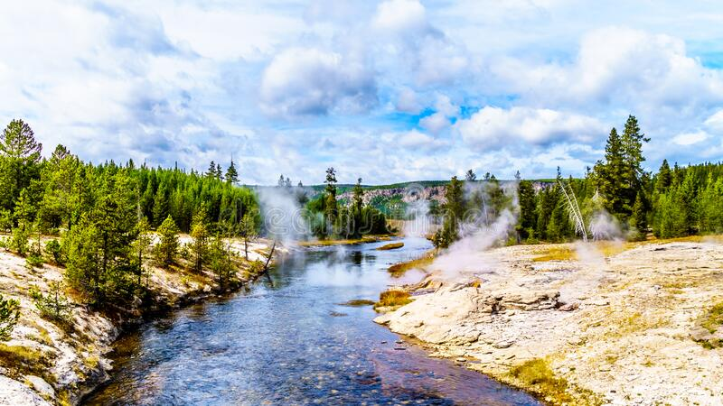 Hot water from the Fan Geyser and several other geysers and hot springs flowing into the Firehole River in Yellowstone National Pa. Hot water from the Fan Geyser royalty free stock images