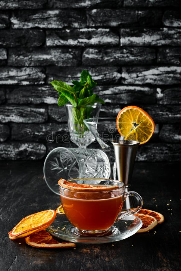 Hot wine with citrus fruits and cinnamon in a cup Hot winter cocktail on a wooden background. Free space for your text. royalty free stock image