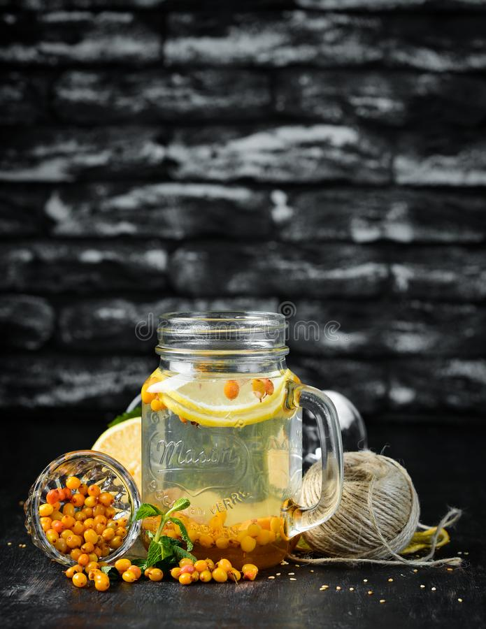 Hot winter tea from sea buckthorn. On a wooden background. Top view. Free copy space stock images