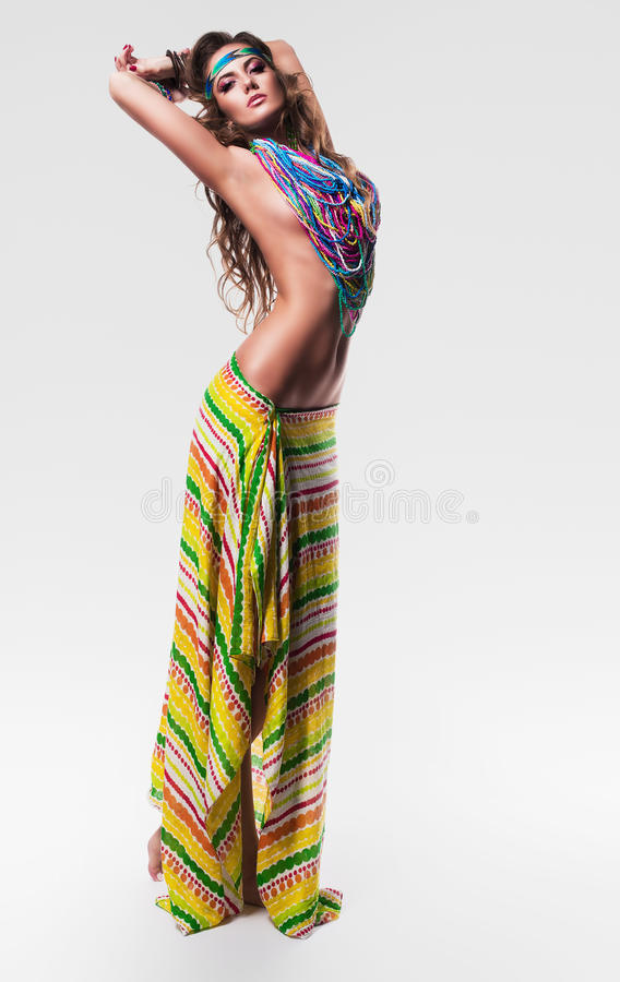 Hot woman in colourful necklace and skirt. In studio royalty free stock photos