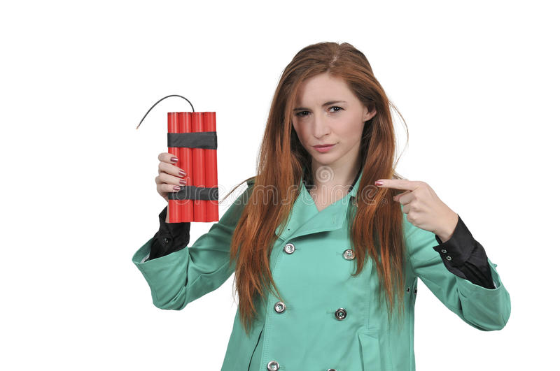Hot woman holding dynamite. Young woman holding sticks of dynamite stock images