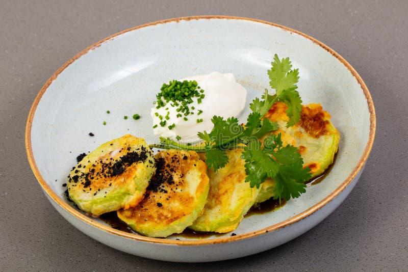 Hot zucchini pancakes stock photos