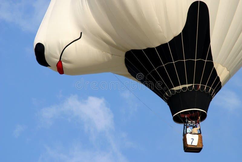 Hotair balloon. A Striped hotair balloon in flight stock photos