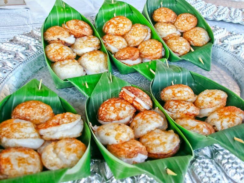 Hotcakes asados a la parrilla dulces y sabrosos del Coco-arroz imagen de archivo