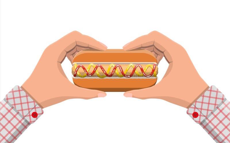 Hotdog i händer royaltyfri illustrationer